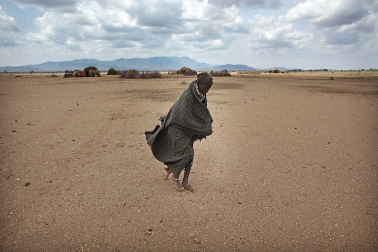 <p>A woman from the remote Turkana tribe in Northern Kenya on November 9, 2009 near Lodwar, Kenya. In 2009, over 23 million people across East Africa were facing critical shortages of water and food due to climate change.</p>