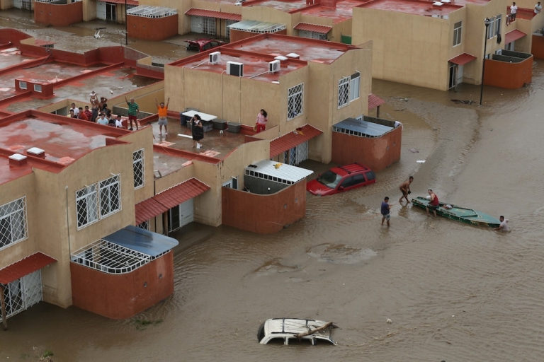 <p>Residents wait for help in Acapulco, state of Guerrero, Mexico, on Sept. 17, 2013 as heavy rains hit the country.</p>