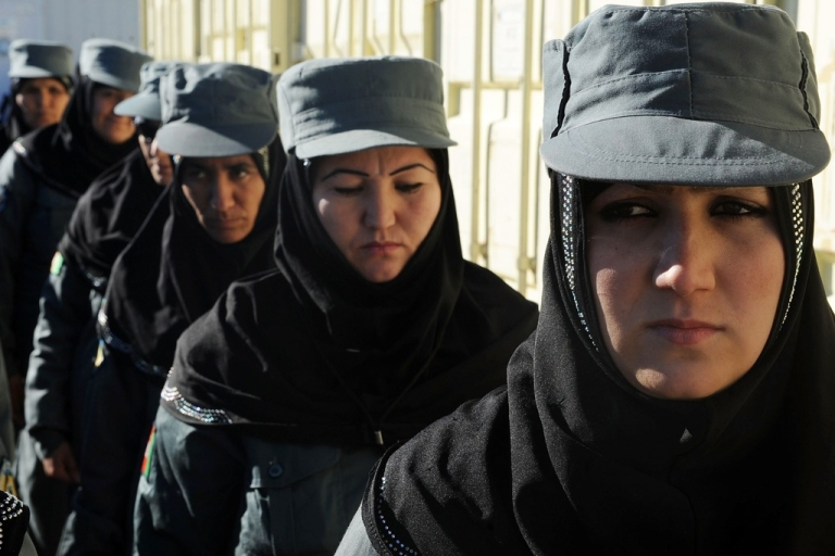 <p>Female Afghan National Police stand at attention during a graduation ceremony at a police training center in Herat on Dec. 20, 2012.</p>