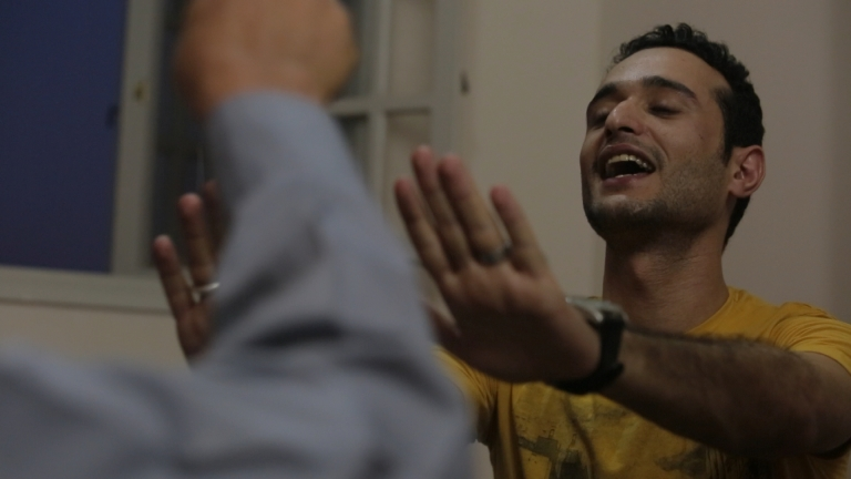 <p>Ahmed Douma, 24, a secular, pro-democracy activist, argues with his father, Saad Douma, 55, a lifelong member of the Muslim Brotherhood, before breaking the fast on the first Friday night of the Muslim holy month of Ramadan on  July 12, 2013.</p>