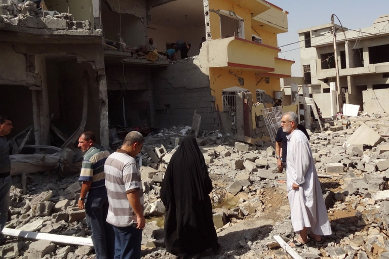 <p>Iraqis inspect the remains of houses after a suicide bomber detonated the day before an explosives-rigged vehicle on August 2013 in the northern city of Tuz Khurmatu.</p>