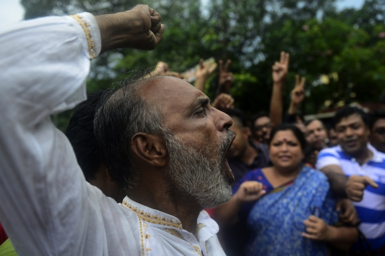 <p>Bangladeshi social activists shout slogans in Dhaka on September 17, 2013, after a verdict was delivered against Abdul Quader Molla, the fourth-highest leader of the Jamaat-e-Islami party. Bangladesh's top court sentenced to death a senior Islamist opposition official for murder during the 1971 liberation war against Pakistan. Abdul Quader Molla is the first politician to be found guilty by the country's Supreme Court after it rejected an appeal to acquit him of all charges.</p>