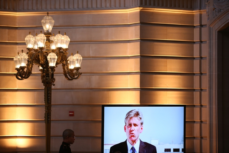 <p>A U.S. Marine watches a video of former Ambassador Christopher Stevens during a memorial service for Stevens at San Francisco City Hall on October 16, 2012 in San Francisco, California.</p>