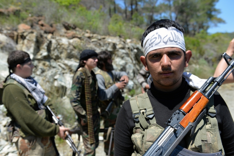 <p>Rebel fighters from the Al-Ezz bin Abdul Salam Brigade attend a training session at an undisclosed location near the al-Turkman mountains, in Syria's northern Latakia province in April.</p>