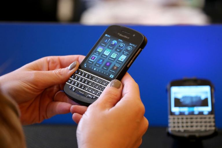 <p>A woman looks at a Blackberry at the New York Times Schools For Tomorrow Conference on Sept. 17, 2013 in New York City. The Wall Street Journal reported on Sept. 18 that BlackBerry intended to cut 40 percent of its workforce.</p>