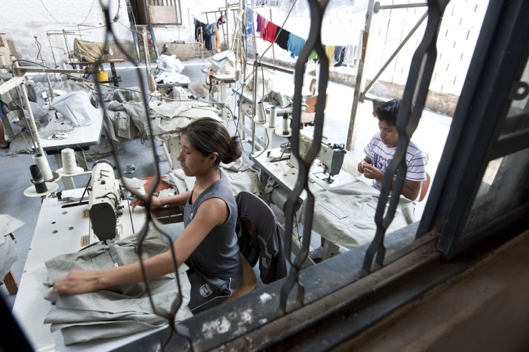 <p>Bolivian immigrants work at a clothing factory in Nova Odessa, Brazil, on Oct. 11, 2011.</p>