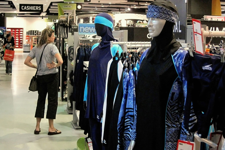 <p>The Islamic full-length swimming suit known as Burqini (or Burkini) sits on display at a sports store in Dubai on August 23, 2009. The three-piece lycra and polyester bodysuit covers the body and hair.</p>