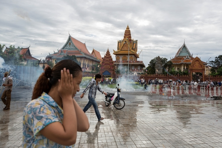 <p>Anti-riot police fire tear gas as clashes erupt near the riverside on Sept. 15, 2013, in Phnom Penh, Cambodia.</p>