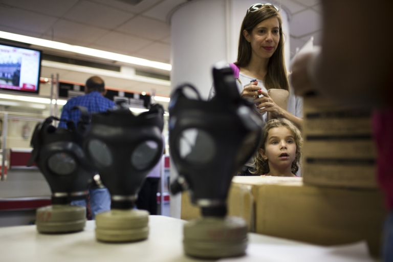 <p>Israelis wait in line to pick their gas masks at a distribution center on August 26, 2013 in Tel Aviv, Israel.</p>