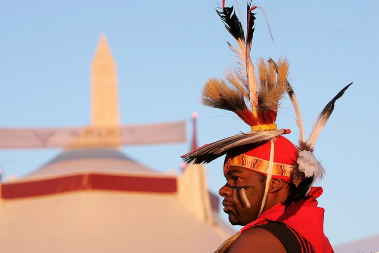<p>Dennis Redmoon of the Seminole-Cherokee Nation watches during the grand opening procession of the Smithsonian's National Museum of the American Indian in Washington, DC, on Sept. 21, 2004.</p>