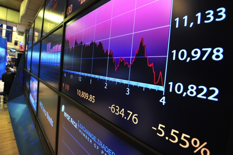 <p>An electronic billboard shows a graph of trading throughout the day and the Dow Jones Industrial Average figures just after the closing bell at the New York Stock Exchange August 8, 2011.</p>
