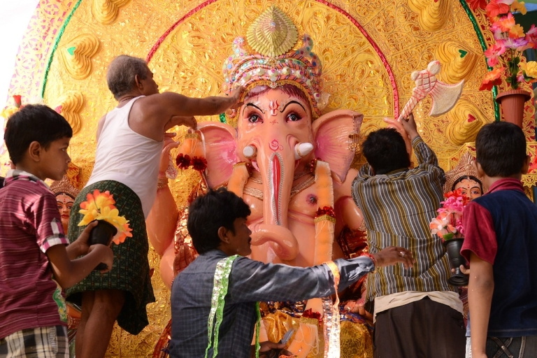 <p>Indian devotees decorate a statue of the Hindu god Lord Ganesh on the eve of the Ganesh Chaturthi festival at a temple in Amritsar in northwestern India on Sept. 8, 2013.</p>