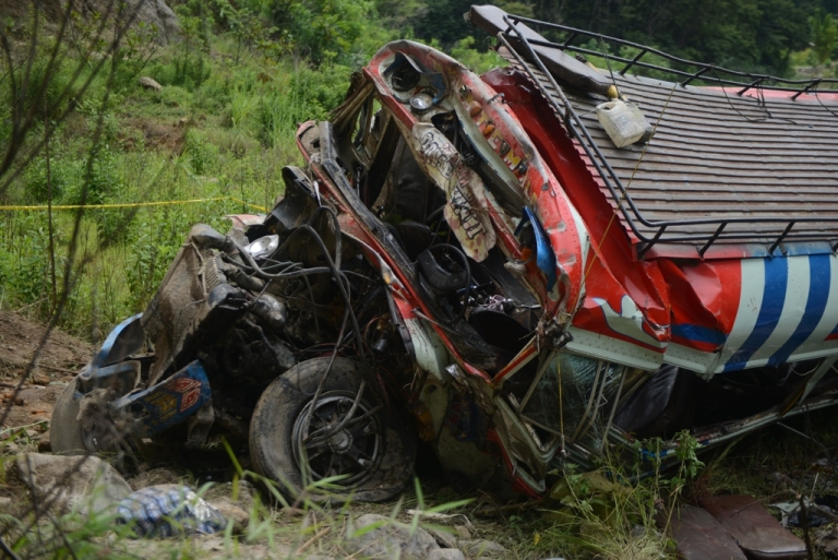 <p>The wreckage of a bus that plunged 230 feet after careening off a road in San Martin Jilotepeque, 40 miles west of Guatemala City, killing dozens of passengers.</p>
