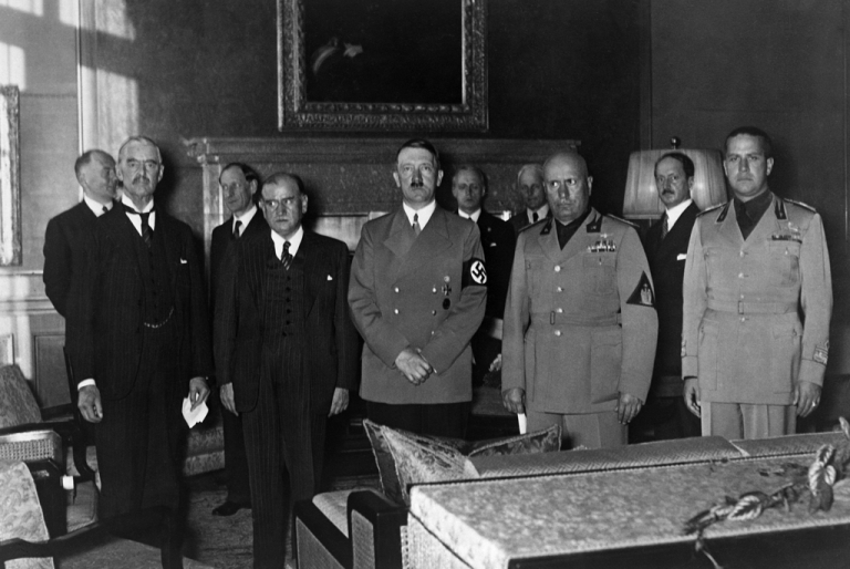 <p>Prime Ministers (left to right) Lord Neville Chamberlain (UK), Edouard Daladier (France), Nazi German Chancellor Adolf Hitler, Benito Mussolini (Italia) and Italian Foreign minister Count Gian Galeazzo Ciano gather in Munich to sign the Munich treaty, Sept. 29, 1938.</p>