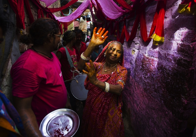<p>An Indian resident dances in an alleyway in front of drummers during a wedding procession in Kathputli Colony in New Delhi on June 7, 2013. Many Indians still prefer arranged marriages.</p>