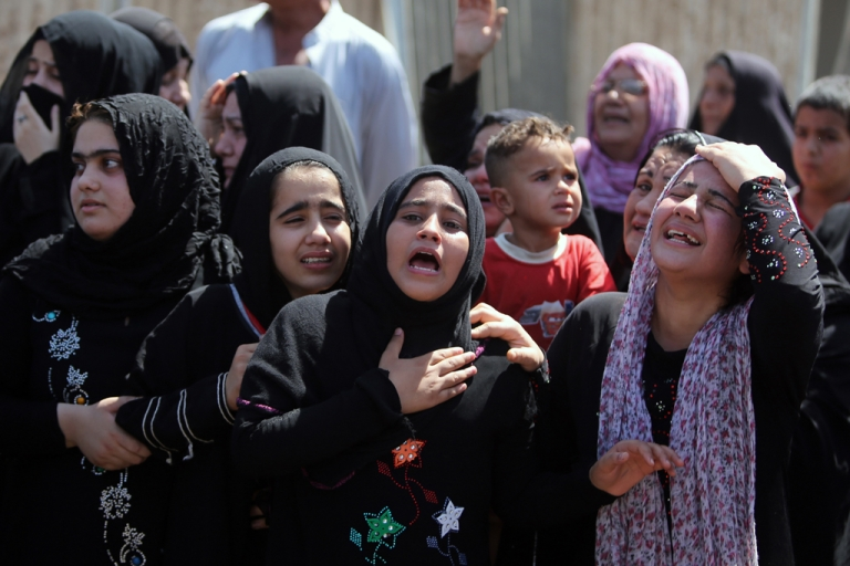 <p>Iraqi girls mourn the death of a relative who was one of the victims of the attack on a Shiite mosque in Baghdad's northern neighborhood of Kasra on September 11, 2013. Another suicide bombing on September 14, 2013 killed at least 21 people.</p>