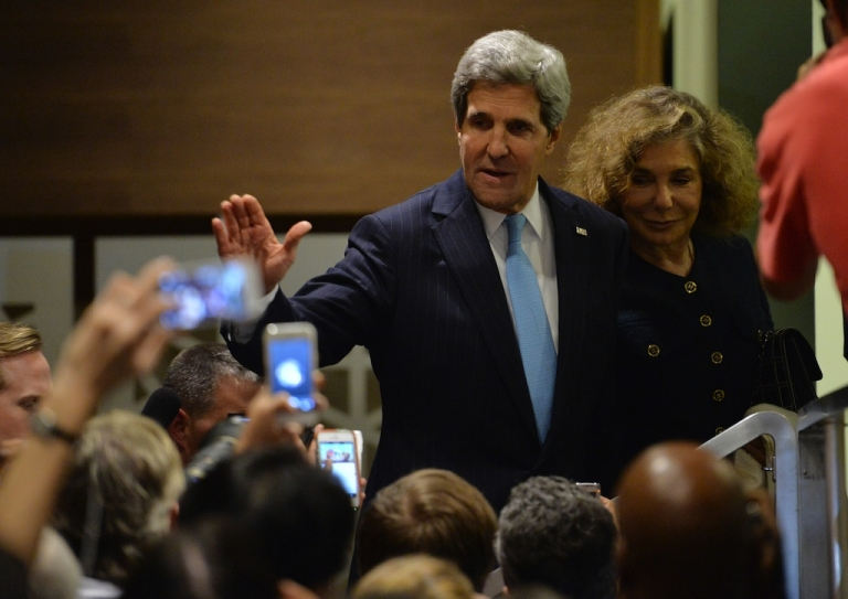 <p>US Secretary of State John Kerry waves to the media outside the UN Security Council on Sept. 27, 2013 after the 15-member body approved a resolution requiring Syria to give up its chemical weapons.</p>