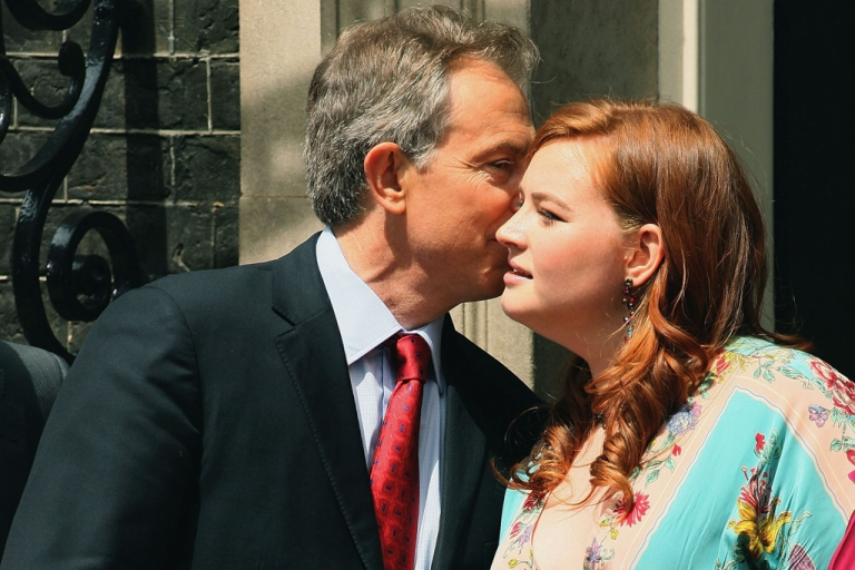 <p>Tony Blair kisses his daughter, Kathryn, before leaving his Downing Street residence for the last time as prime minister on June 27, 2007, in London.</p>