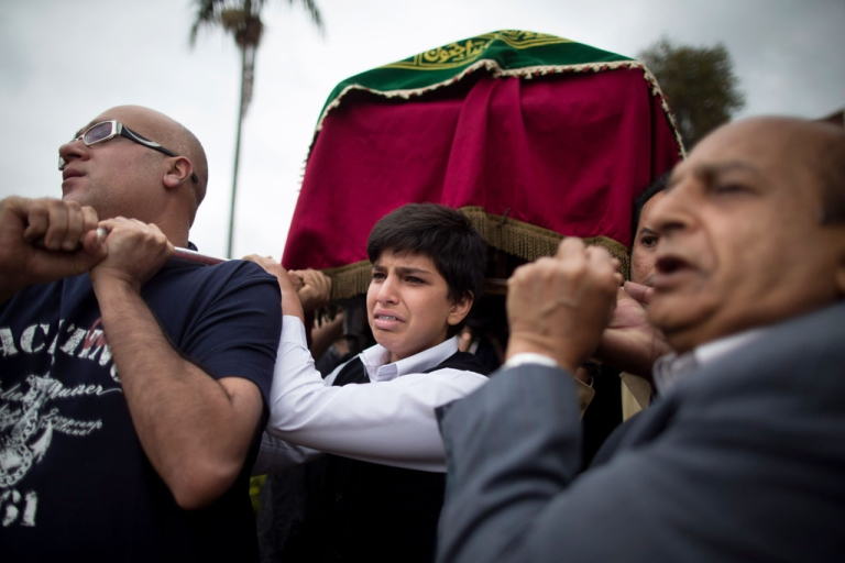 <p>Relatives carry a coffin during a funeral procession on September 25, 2013 in Nairobi, Kenya, for Selima Merali and her 15-year-old daughter, Nuriana Merali, who died during the attack at the Westgate mall. The country is observing three days of national mourning as security forces begin the task of clearing and securing the Westgate shopping mall following a four-day siege by militants.</p>
