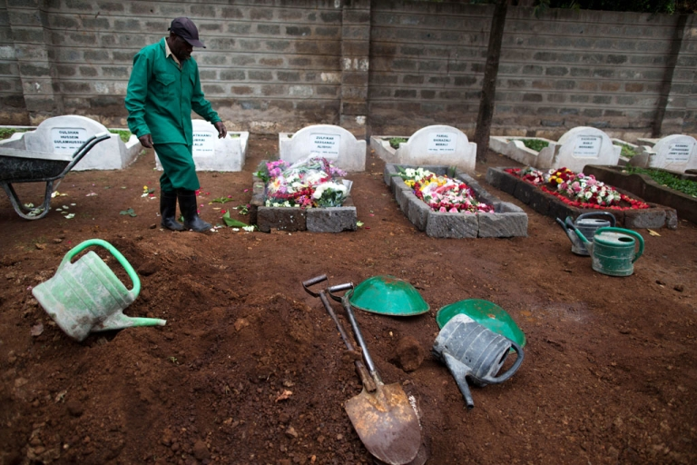 <p>A cemetery worker walks next to fresh graves on September 25, 2013 after the funeral for Selima Merali, 41, and daughter Nuriana Merali, 15, who were killed in the attack by gunmen at the Westgate mall in Nairobi, Kenya. The country is observing three days of national mourning as security forces begin the task of clearing and securing the Westgate shopping mall following a four-day siege by militants.</p>