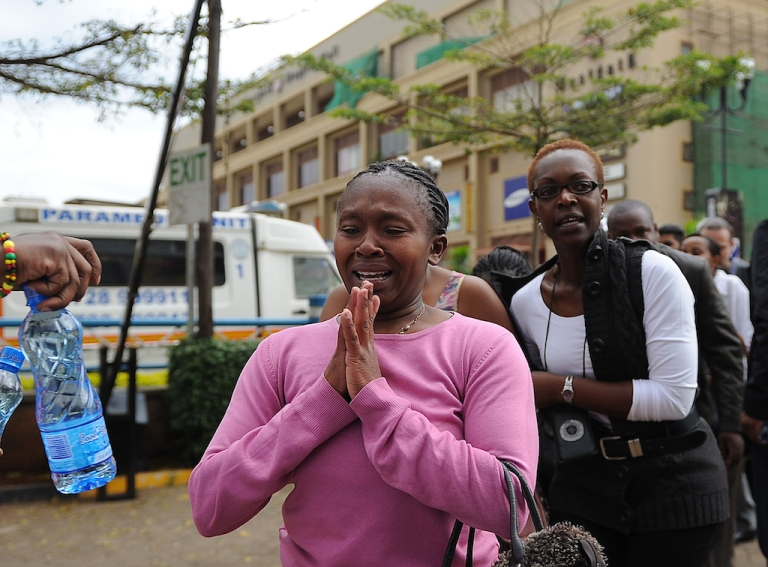 <p>A woman who had been held hostage reacts following a security operation at an upmarket shopping mall, where suspected terrorists engaged Kenyan security forces in a drawn out gun fight on September 21, 2013 in Nairobi.</p>