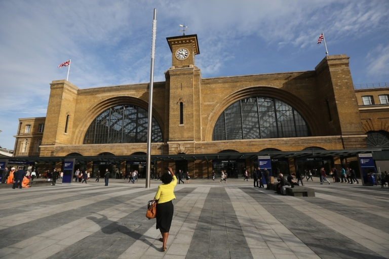 <p>Members of the public walk through the newly opened King's Cross Square on September 26, 2013 in London, England. The opening of the square, which reveals the original facade of King's Cross station for the first time in 150 years, marks the final stage in the 550 million GBP redevelopment of the station.</p>