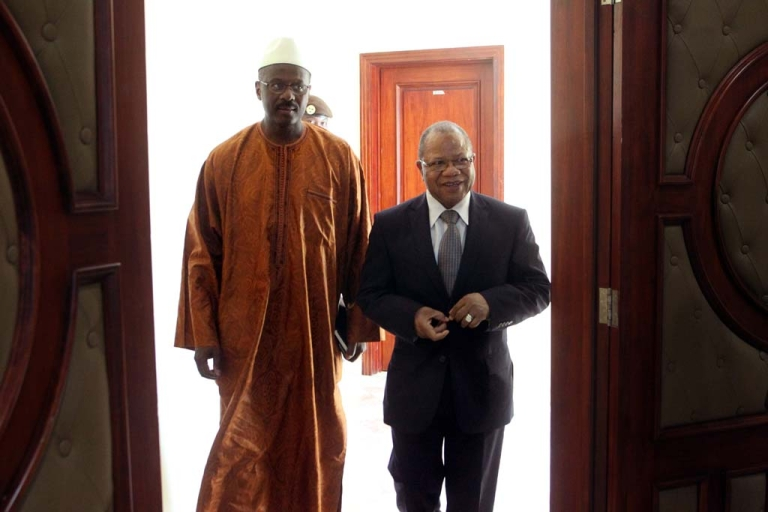 <p>Former Malian Prime minister Django Sissoko (right) welcomes newly appointed Prime Minister Oumar Tatam Ly (left) on Sept. 6, 2013 in Bamako.</p>