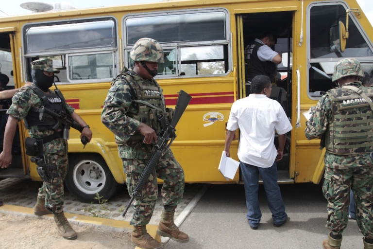 <p>Forensic personnel work a crime scene in which a bus driver and his two assistants were killed by gunmen inside a bus in Acapulco's Cayaco neighborhood, in the state of Guerrero, Mexico, on March 11, 2013.</p>