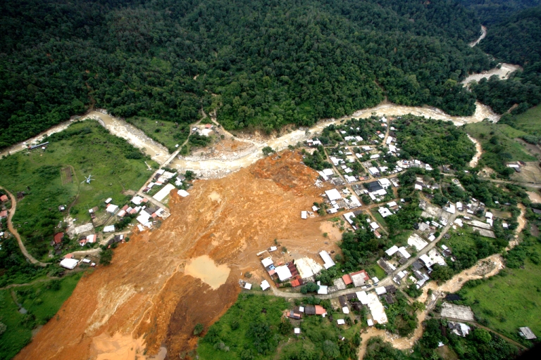 <p>Aerial view of the landslide that buried part of La Pintada village, Guerrero state, Mexico, after heavy rains hit the area, on September 19, 2013. Deaths from floods and landslides battering Mexico neared 100 on Thursday.</p>