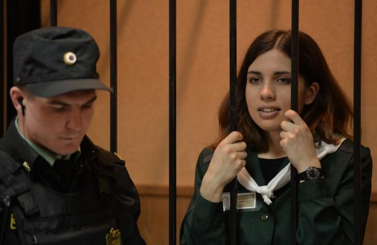 <p>Nadezhda Tolokonnikova looks on while standing in the defendant's cage in Zubova Polyana, in the Republic of Mordovia.</p>