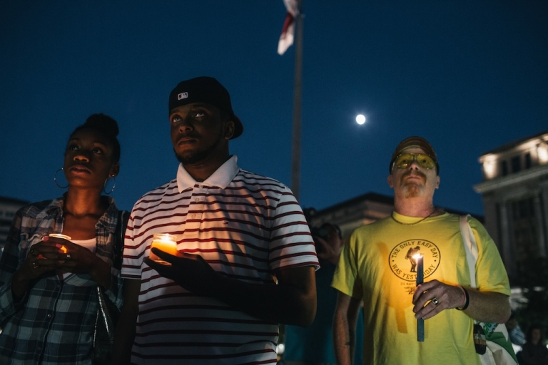<p>People hold candles in remembrance of those affected by gun violence during a vigil at Freedom Plaza on Sept. 16, 2013 in Washington, DC.</p>