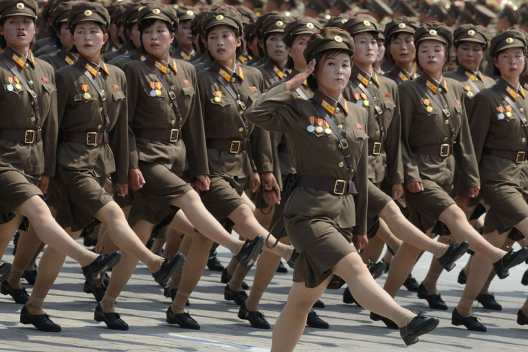 <p>North Korean soldiers march through Kim Il-Sung square in Pyongyang on July 27, 2013, to mark the 60th anniversary of the Korean armistice.</p>