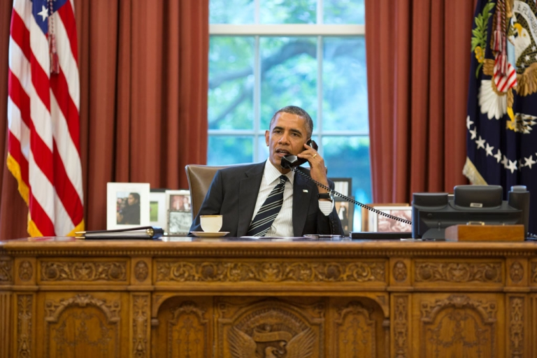 <p>President Barack Obama speaks with President Hassan Rouhani of Iran on the phone in the Oval Office, Sept. 27, 2013.</p>