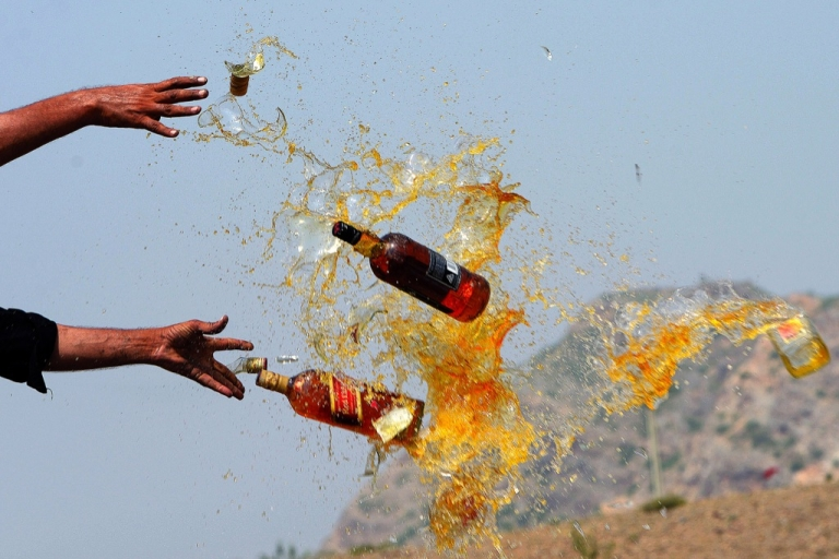 <p>Pakistani Frontier Corps personnel break liquor bottles in the Shahkas area of the Jamrud Khyber Agency, one of the Federally Administered Tribal Areas, on June 26, 2013. Officials destroyed the contraband as part of the UN's International Day Against Drug Abuse and Illicit Trafficking.</p>