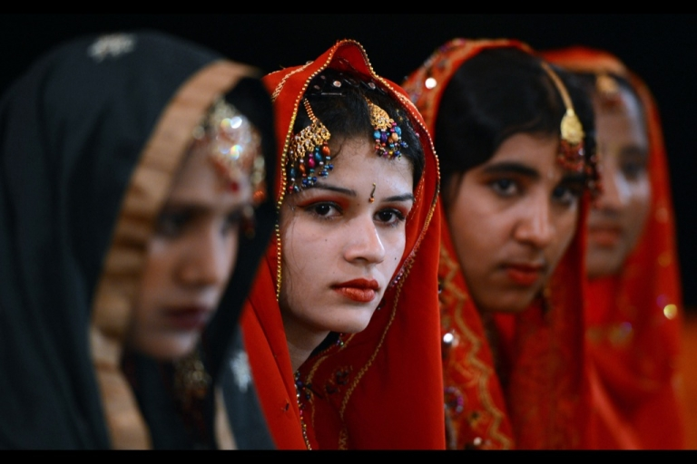 <p>Pakistani brides attend a mass marriage ceremony in Karachi on March 26, 2013.</p>