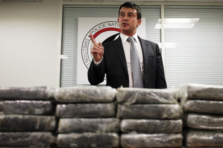 <p>French Interior minister Manuel Valls talks to journalists in front of cocaine seized by French police, on September 21, 2013 in Nanterre, France. Valls announced 1.3 tonnes of pure cocaine was found on board an Air France cargo plane. A source close to the investigation said the flight had originated in the Venezuelan capital Caracas, adding that the haul had a street value of some 200 million euros ($270 million).</p>