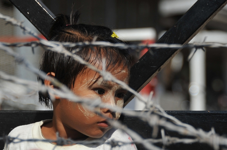 <p>A young girl awaits the release of a relative from Yangon's Insein prison in Yangon in January, 2011. Myanmar has freed hundreds of political prisoners. After successfully liberalizing their government, many of these democracy advocates have returned home to shattered lives and broken families.</p>