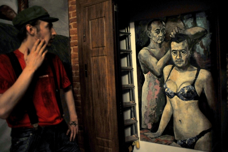 <p>A visitor looks at the confiscated painting by Konstantin Altunin last month.</p>