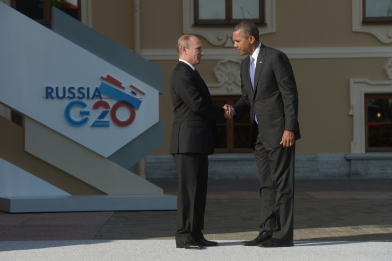 <p>In this handout image provided by Host Photo Agency, Russian President Vladimir Putin greets US President Barack Obama at the G20 summit on Sept. 5, 2013.</p>