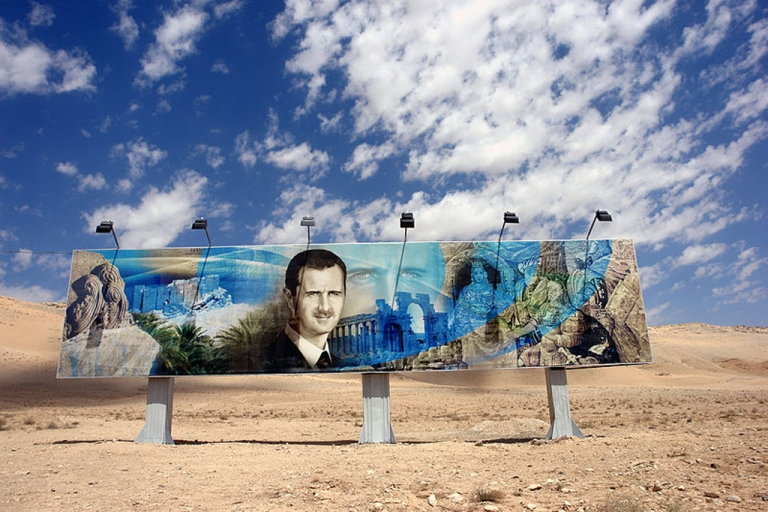 <p>Roadside mural of Bashar al-Assad along the highway in Aleppo, Syria.</p>