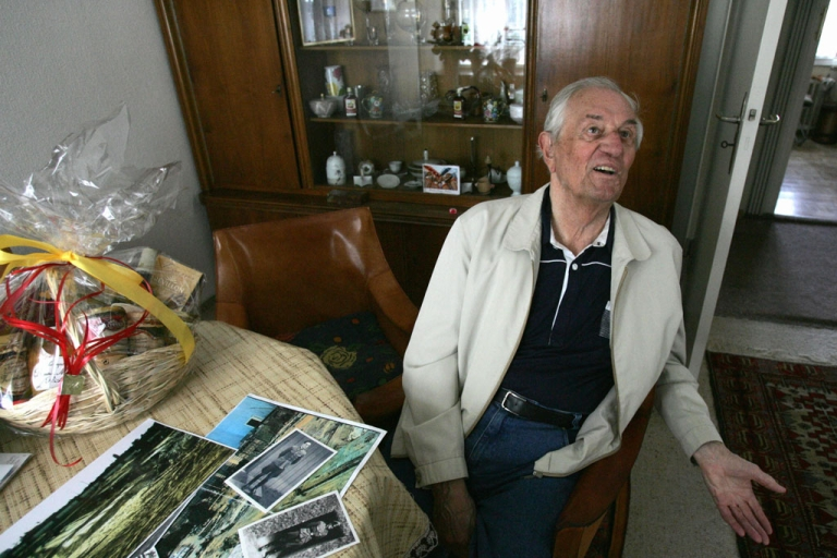 <p>Rochus Misch, a former bodyguard to Adolf Hitler, sits in his Berlin home on May 2, 2005. Misch died on Sept. 5, 2013 at age 96 after a heart attack.</p>