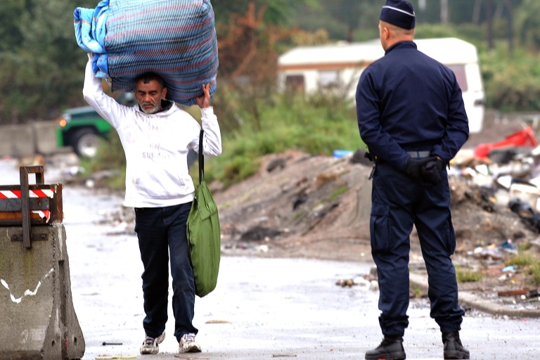 <p>Police evacuate Roma from an encampment near the French city of Lille this month.</p>