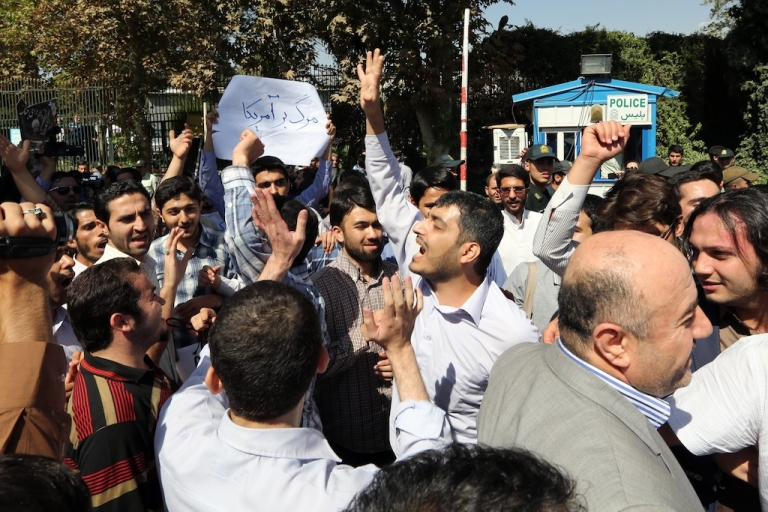 <p>Iranian supporters of the Basiji militia shout anti US slogans as Iranian president Hassan Rouhani arrived from New York, on September 28, 2013 in Tehran. Some 60 hardline Islamists chanted 'Death to America' and 'Death to Israel' but they were outnumbered by 200 to 300 supporters of the president who shouted: 'Thank you Rouhani.'</p>