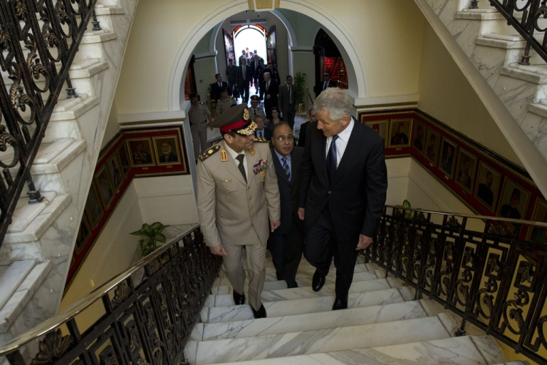 <p>U.S. Secretary of Defense Chuck Hagel, right, walks with Egyptian Minister of Defense Gen. Abdel-Fattah el-Sisi into the Ministry of Defense in Cairo April 24, 2013. Egypt was Hagel's fourth stop on a six-day trip to the Middle East to meet with defense counterparts.</p>