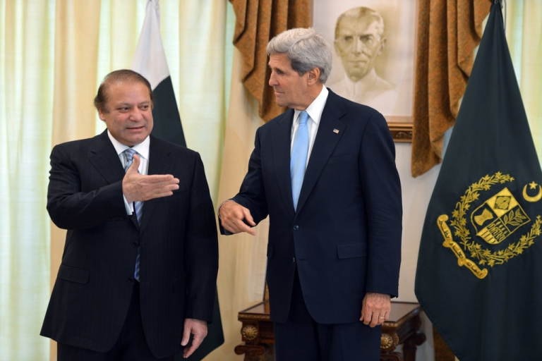 <p>US Secretary of State John Kerry (R) speaks with Pakistani Prime Minister Nawaz Sharif at the Prime Minister's House in Islamabad on August 1, 2013. Kerry invited Pakistan's prime minister to talks with President Barack Obama, seeking to upgrade fractious ties dominated by rows over drone strikes and Islamist militants.</p>