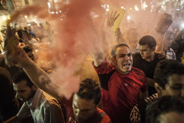 <p>Muslim Brotherhood members and ousted president Mohamed Morsi supporters shout slogans and light up flares during a demonstration against the military backed government on September 10, 2013 in Cairo, Egypt.</p>