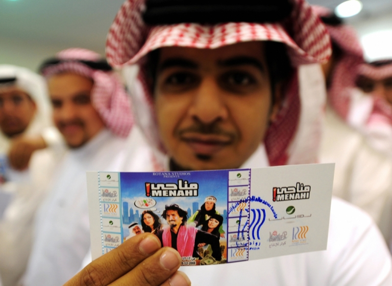 <p>A Saudi man holds up his entrance ticket to see the Saudi comedy film 'Manahi' at a theatre in Jeddah in 2008. The conservative kingdom normally places a blanket ban on public film screenings and movie theaters.</p>
