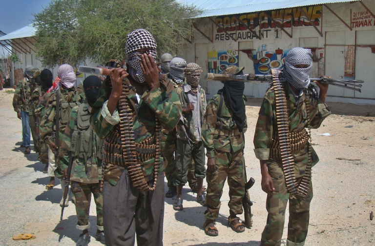 <p>Al Qaeda-linked Al Shabaab recruits walk down a street in Mogadishu in 2012. Analysts say most of the group's foreign fighters come from Kenya, where a terrorist attack on an upscale shopping mall killed at least 68 people this weekend.</p>