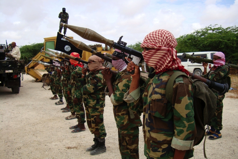 <p>Militants belonging to Somalia's Al-Qaeda-inspired Al Shabaab Islamists stand in formation during a show of force in Somalia's capital Mogadishu in 2010.</p>