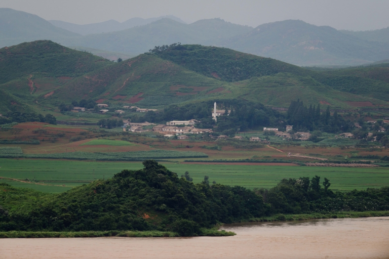 <p>A photo taken on July 16, 2013 shows a North Korean propaganda village of Jangdan-myeon on the edge of the Imjingang river seen from the Odu Mountain Unification Observatory in Paju, South Korea.</p>